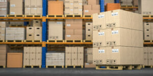 pallets stored in a warehouse by a logistics and transloading company Houston and San Antonio